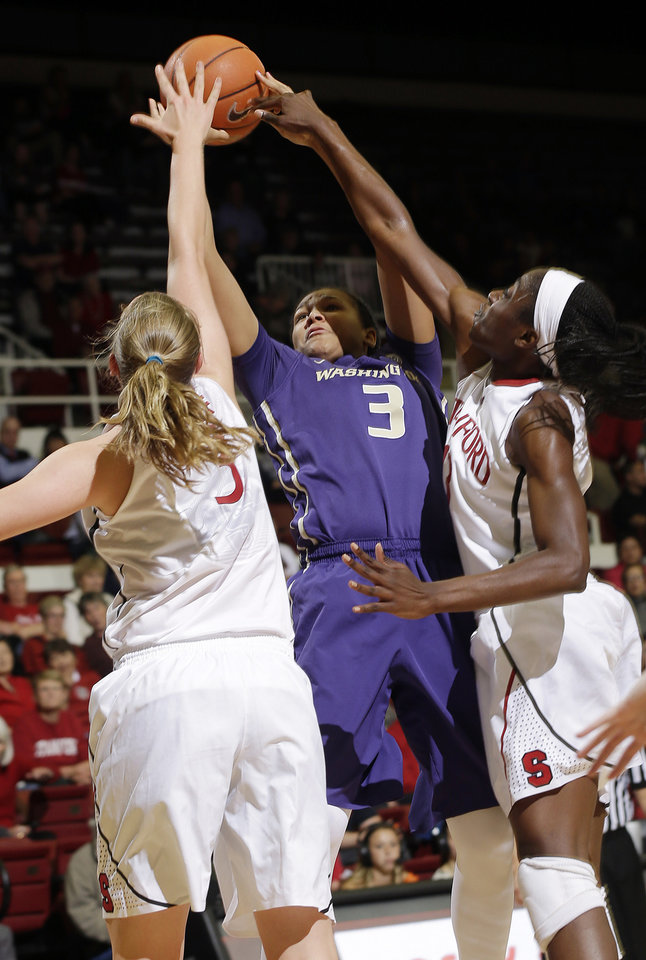 Photo - Washington forward Talia Walton (3) tries to shoot between Stanford forward Mikaela Ruef, left, and forward Chiney Ogwumike during the first half of an NCAA college basketball game, Thursday, Feb. 27, 2014, in Stanford, Calif. (AP Photo/Marcio Jose Sanchez)