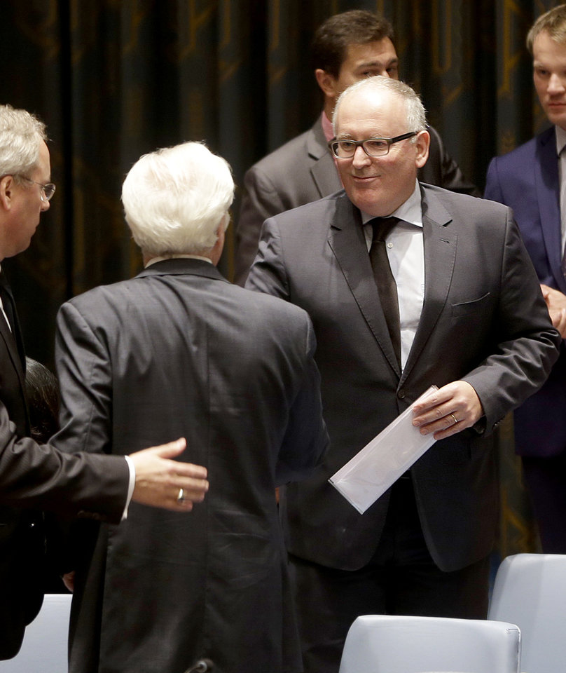 Photo - Dutch Foreign Minister Frans Timmermans, right, greets Russian Ambassador to the United Nations Vitaly Churkin before a security council meeting at United Nations headquarters, Monday, July 21, 2014. (AP Photo/Seth Wenig)