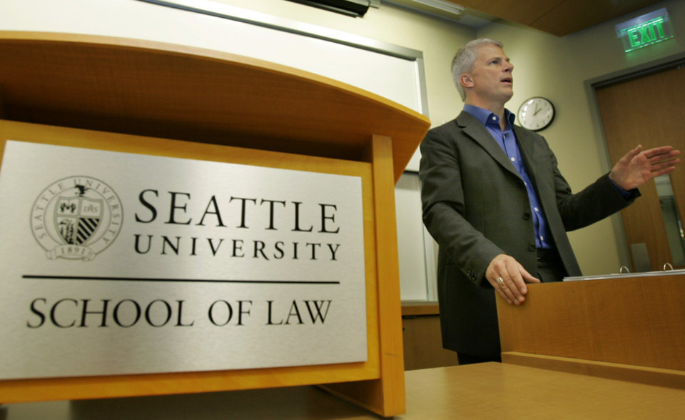 Photo - ADVANCE FOR USE MONDAY, DEC. 3, 2012 AND THEREAFTER - FILE - In this Tuesday, March 27, 2007 file photo, former U.S. Attorney John McKay teaches a class at the School of Law at Seattle University in Seattle. In November 2009, McKay, well respected, from a prominent Republican family and who had served as the Justice Department's top prosecutor in western Washington - charged with carrying out U.S. drug laws, called for a top-to-bottom review of the nation's drug war and endorsed regulating marijuana like alcohol. (AP Photo/Ted S. Warren)