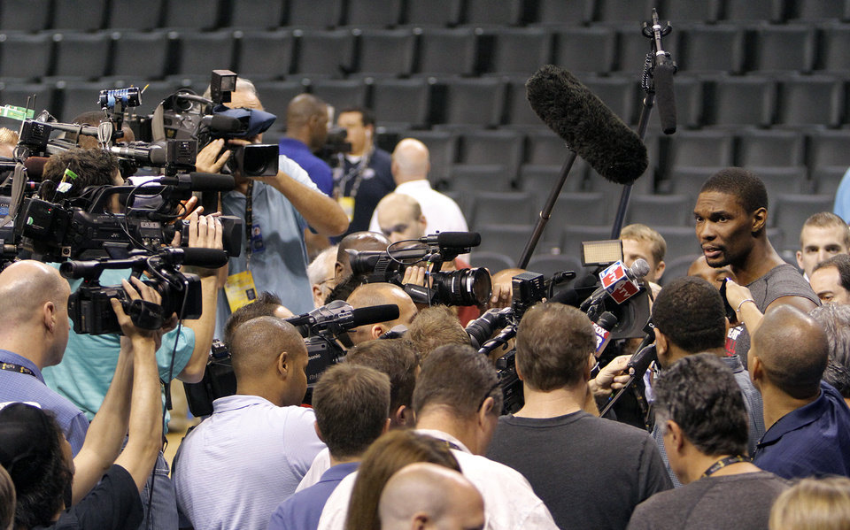 Photo - Miami's Chris Bosh talks to the media during the NBA Finals practice day at the Chesapeake Energy Arena on Monday, June 11, 2012, in Oklahoma City, Okla. Photo by Chris Landsberger, The Oklahoman