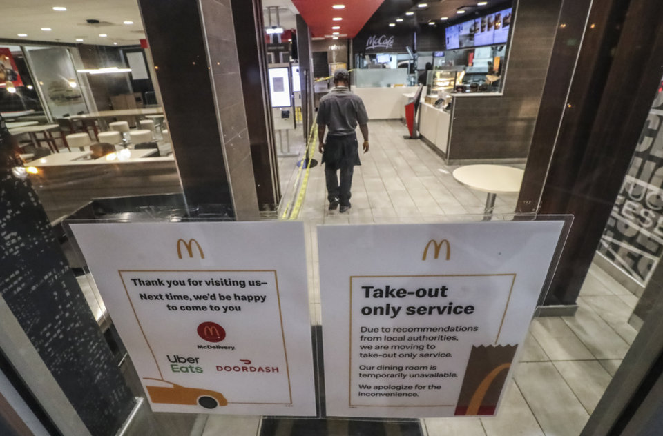 Photo - McDonald's on Cascade Road in South Fulton in Atlanta is employing a take-out Service only and has its dining room closed on Thursday, March 19, 2020. (John Spink/Atlanta Journal-Constitution via AP)