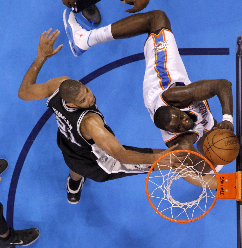 Photo - Oklahoma City's Kendrick Perkins (5) goes past San Antonio's Tim Duncan (21) during Game 4 of the Western Conference Finals between the Oklahoma City Thunder and the San Antonio Spurs in the NBA playoffs at the Chesapeake Energy Arena in Oklahoma City, Saturday, June 2, 2012. Photo by Bryan Terry, The Oklahoman