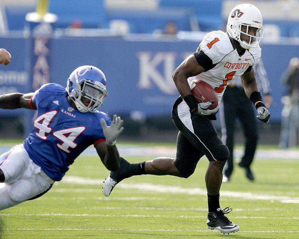 Photo - Oklahoma State's Joseph Randle (1)gets by Kansas' Olaitan Oguntodu (44)during the college football game between Oklahoma State (OSU) and Kansas (KU), Saturday, Nov. 20, 2010 at Memorial Stadium in Lawrence, Kan. Photo by Sarah Phipps, The Oklahoman