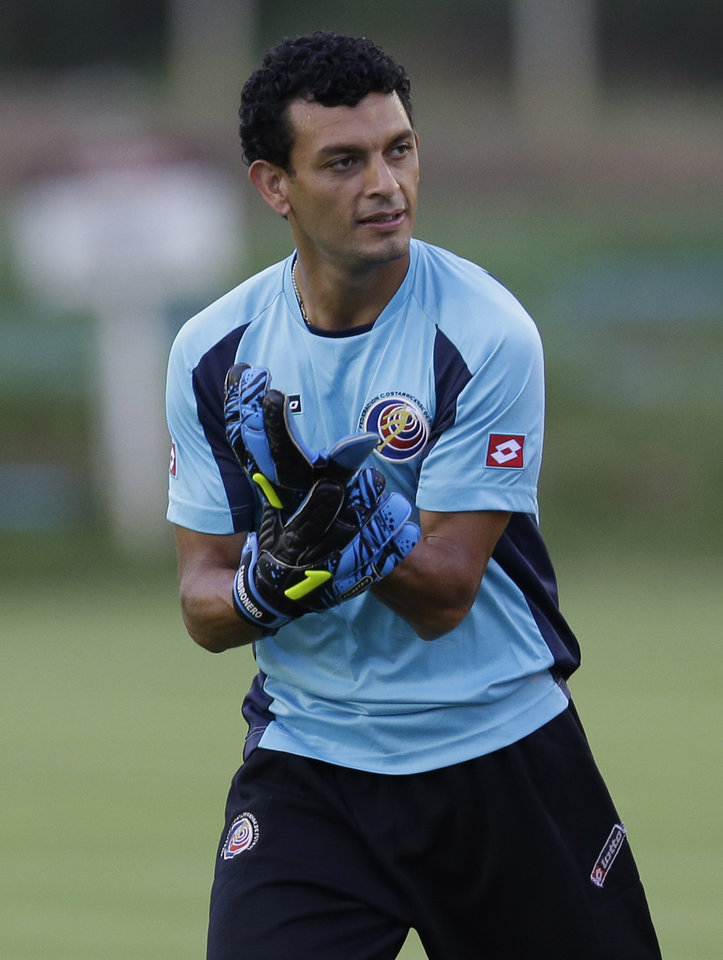 Photo - Costa Rica's Michael Barrantes wears gloves as he prepares to play as goalkeeper during a training session of Costa Rica in, Recife      , Brazil, Saturday, June 28, 2014. Costa Rica will play Greece in a World Cup round of 16 soccer match next June 29.(AP Photo/Andrew Medichini)