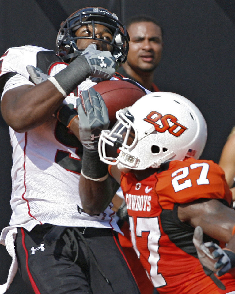 Texas Tech's Michael Crabtree (5) pulls in a pass over Oklahoma State's Calvin Mickens (27) for a touchdown during the first half of the college football game between the Oklahoma State University Cowboys (OSU) and the Texas Tech University Red Raiders (TTU) at Boone Pickens Stadium  on Saturday, Sept. 22, 2007, in Stillwater, Okla. 