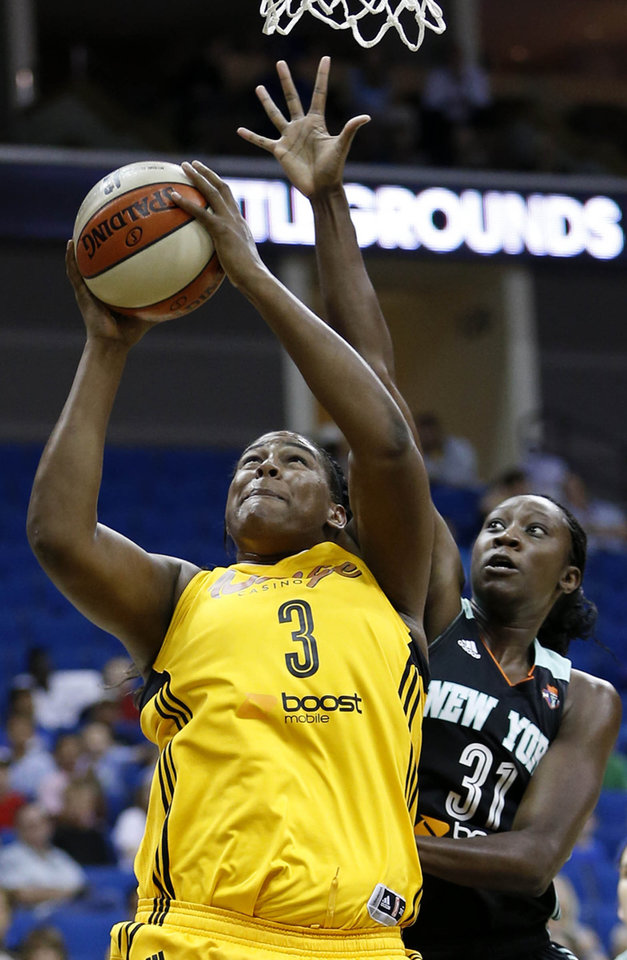 The Tulsa Shock\'s Courtney Paris (right) shoots under pressure from New York Liberty\'s Tina Charles during a basketball game at the BOK Center in Tulsa, Okla. on Tuesday, June 10, 2014. MATT BARNARD/Tulsa World