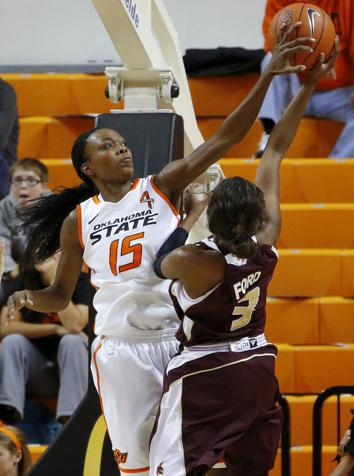 Photo - Oklahoma State's Toni Young (15) blocks the shot of Texas State's Diamond Ford (3) during a women's college basketball game between Oklahoma State University and Texas State at Gallagher-Iba Arena in Stillwater, Okla., Wednesday, Nov. 28, 2012.  Photo by Bryan Terry, The Oklahoman