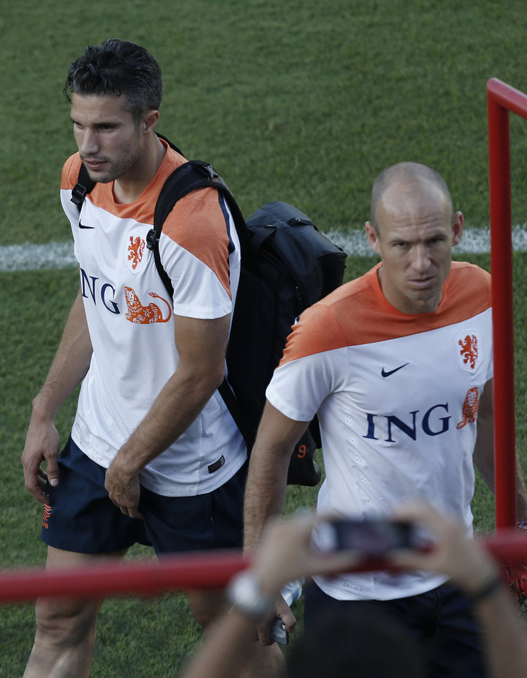 Photo - Netherlands' Arjen Robben, right, and Robin Van Persie are seen during a training session, Sunday, July 6, 2014, in Rio de Janeiro, Brazil. The Netherlands play their semifinal match of the 2014 World Cup soccer tournament against Argentina in Sao Paulo. (AP Photo/Silvia Izquierdo)