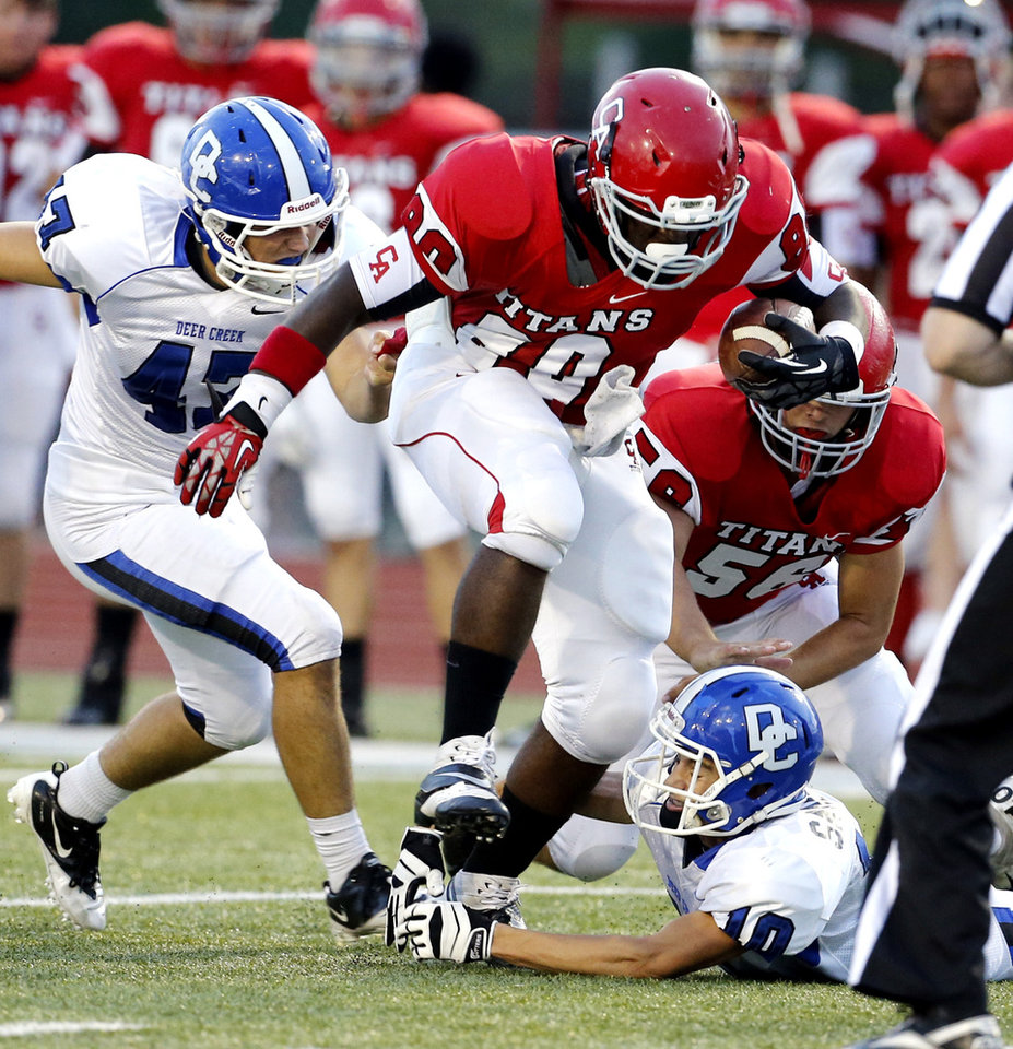 Carl Albert's Chantz Woodberry steps out of a tackle attempt by Deer Creek's Kyle Sander during a high school football game between the Carl Albert Titans and the Deer Creek Antlers on Friday, Sept. 27, 2013 in Midwest City, Okla. Photo by Steve Sisney, The Oklahoman