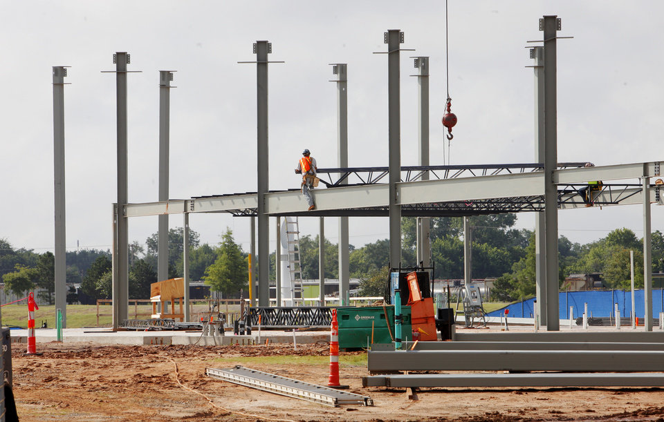 Photo -  Construction continues on CHK/Central Boathouse in the Boathouse District in Oklahoma City. PHOTO BY PAUL B. SOUTHERLAND, THE OKLAHOMAN   PAUL B. SOUTHERLAND -