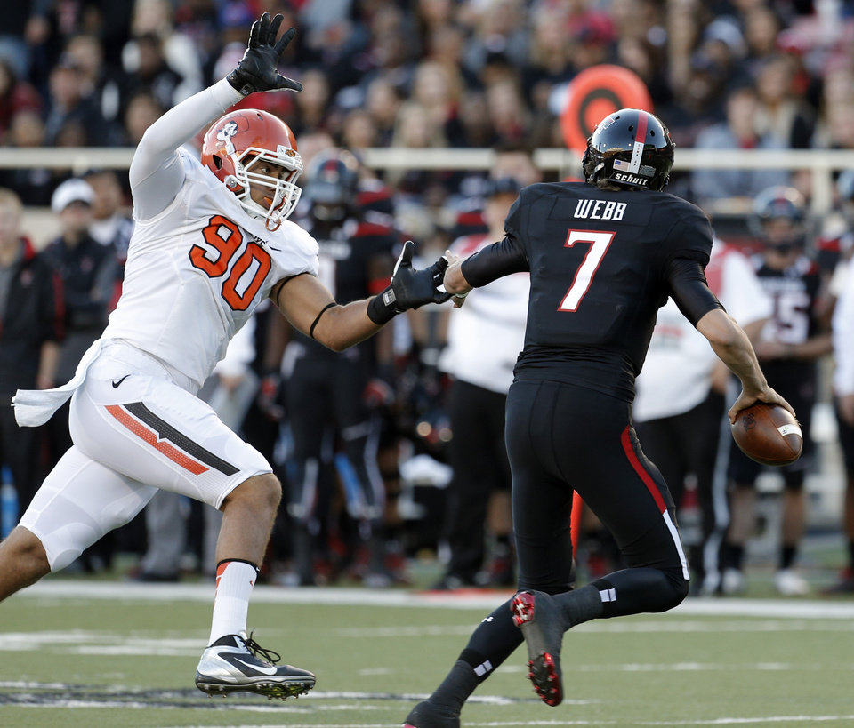Oklahoma State 's Trace Clark (90) pressures Texas Tech's Davis Webb (7) during the college football game between the Oklahoma State Cowboys (OSU) and the Texas Tech Red Raiders (TTU) at Jones AT&T Stadium in Lubbock, Texas, Saturday, Nov. 2, 2013. Photo by Sarah Phipps, The Oklahoman