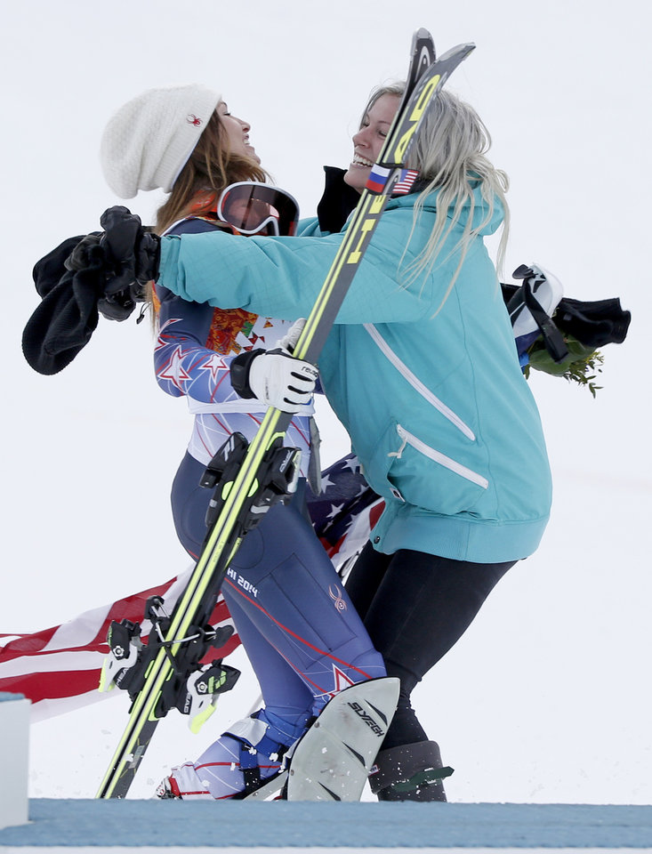 Photo - United States' bronze medal winner in the women's supercombined Julia Mancuso embraces her sister Sara after a flower ceremony at the Alpine ski venue in the Sochi 2014 Winter Olympics, Monday, Feb. 10, 2014, in Krasnaya Polyana, Russia. (AP Photo/Christophe Ena)