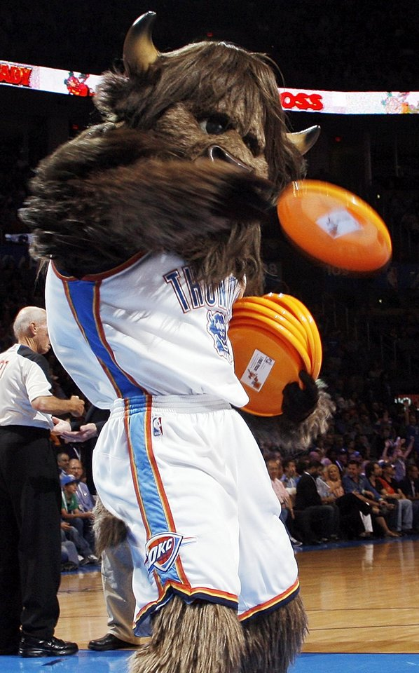 Thunder mascot Rumble the Bison tosses flying discs into the crowd during the NBA basketball game between the Oklahoma City Thunder and the Sacramento Kings at Chesapeake Energy Arena in Oklahoma City, Friday, April 13, 2012. Photo by Nate Billings, The Oklahoman