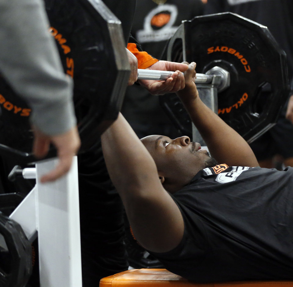Photo - Oklahoma State offensive lineman Marcus Keyes prepares to bench press weight during OSU Pro Day in Stillwater, Okla., Tuesday, March 10, 2020. [Nate Billings/The Oklahoman]