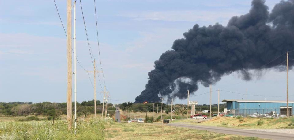 Photo - Smoke billows from a trucking company Saturday in Elk City. Photo by Larissa Graham, Elk City Daily News/AP