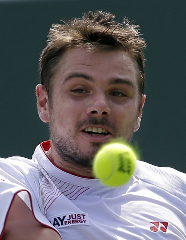 Photo - Stanislas Wawrinka, of Switzerland, keeps his eyes on the ball as he prepares to hit a shot to Daniel Gimeno-Traver, of Spain, during a match at the Sony Open tennis tournament in Key Biscayne, Fla., Saturday, March 22, 2014. (AP Photo/Alan Diaz)