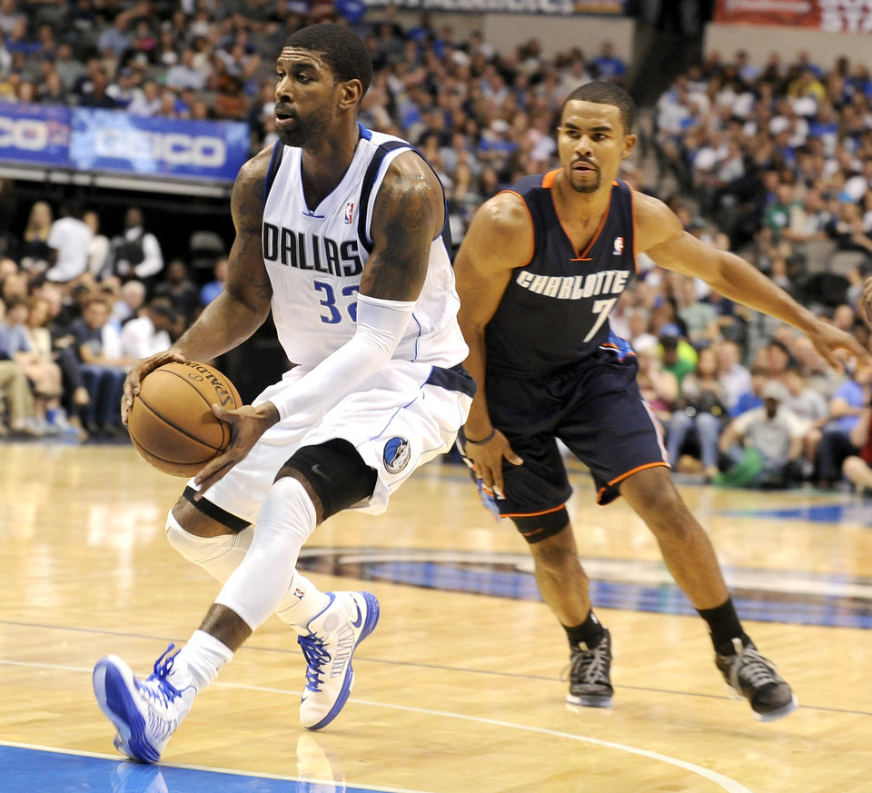 Dallas Mavericks guard O.J. Mayo (32) drives past Charlotte Bobcats guard Ramon Sessions (7) in the second half during an NBA basketball game, Saturday, Nov. 3, 2012 in Dallas. Dallas won 126-99. (AP Photo/Matt Strasen)