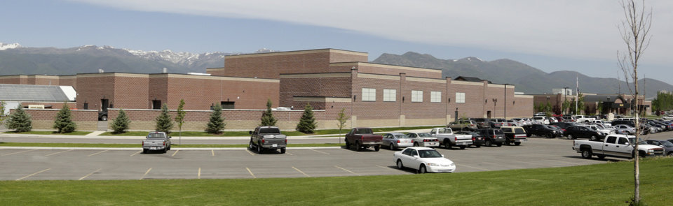 Photo - The Wasatch High School is shown Thursday, May 29, 2014, in Heber City, in Utah. A group of Utah high school students said they were shocked and upset to discover their school yearbook photos were digitally altered, with sleeves and higher necklines drawn on to cover up bare skin. Several students at Wasatch High School in Heber City say that their outfits did meet the school dress code and they've worn them on campus many times.  (AP Photo/Rick Bowmer)