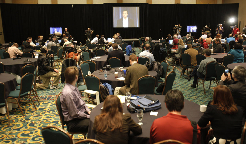 Photo - Members of the media watch from a conference room at the Sawgrass Mariott hotel as golfer Tiger Woods delivers a statement, Friday, Feb. 19, 2010, in Ponte Vedra Beach, Fla. (AP Photo/Rob Carr) ORG XMIT: FLRC109