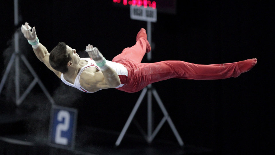 Photo - The University of Oklahoma's Jake Dalton competes in the high bar at the event finals of the men's NCAA Men's Gymnastics Championships at the Lloyd Noble Center on Saturday, April 21, 2012, in Norman, Okla.  Photo by Steve Sisney, The Oklahoman