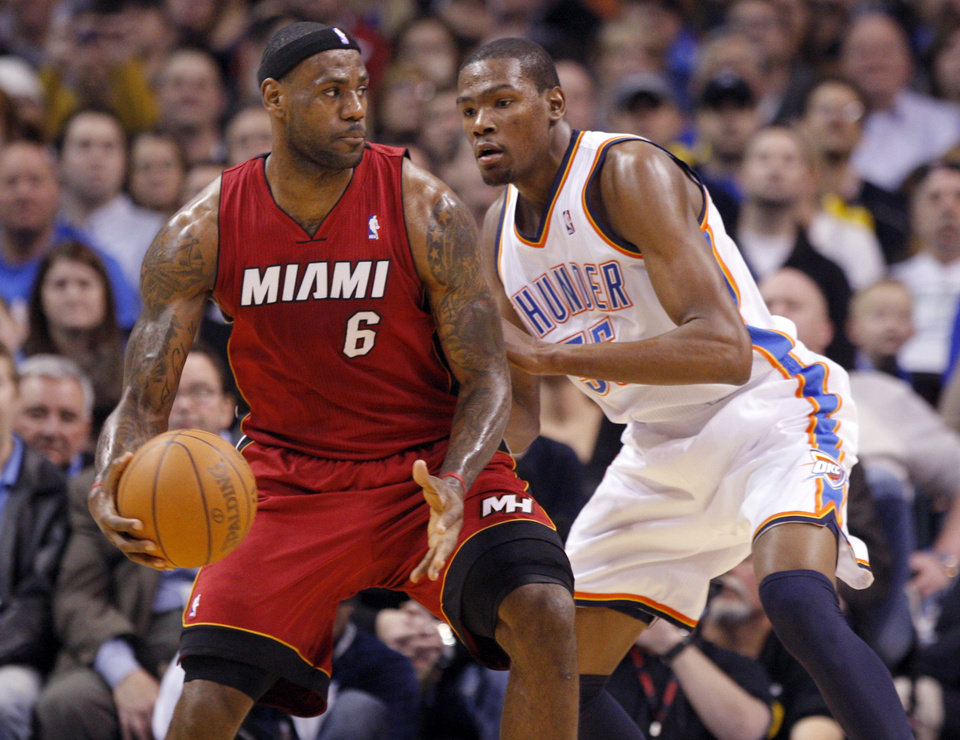 Oklahoma City\'s Kevin Durant (35) guards Miami\'s LeBron James (6) during the NBA basketball game between Oklahoma City and Miami at the OKC Arena in Oklahoma City, Thursday, Jan. 30, 2011. Photo by Sarah Phipps, The Oklahoman