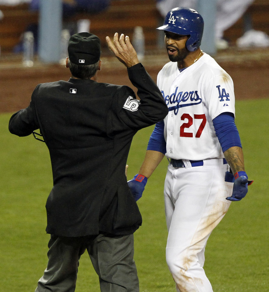 Photo - Home plate umpire Angel Hernandez, left, ejects Los Angeles Dodgers' Matt Kemp (27), after a third called strike, in the ninth inning of a baseball game against the Colorado Rockies on Friday, April 25, 2014, in Los Angeles. (AP Photo/Alex Gallardo)