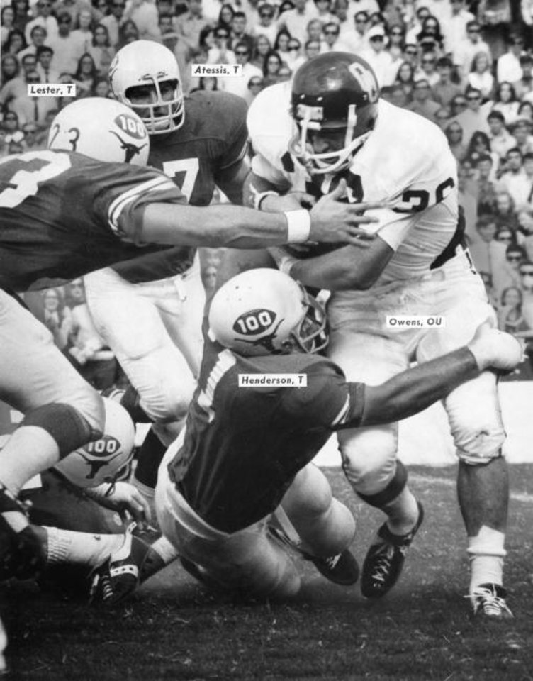 Photo -  Three Texas Longhorns try to stop tailback Steve Owens during the 1969 OU-Texas game. [Oklahoman archives]