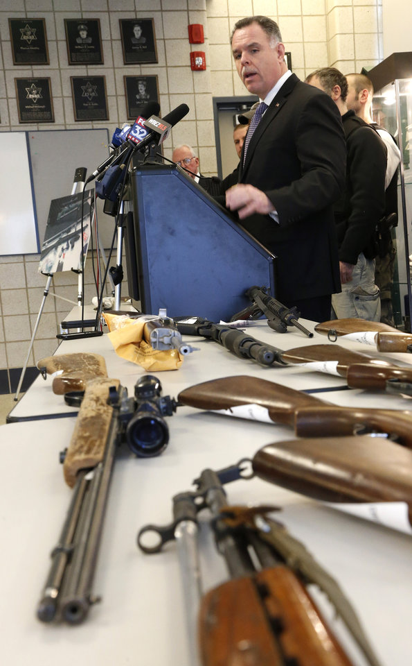 Photo - Chicago Police Superintendent Garry McCarthy stands near guns confiscated in Chicago and talks about the department's efforts to curb gun violence during a news conference Monday, Feb. 4, 2013, in Chicago. Police say they are receiving many tips as they investigate last week's shooting death of a 15-year-old Hadiya Pendleton. But there is also a concern that people with valuable information may not be coming forward and others wonder if people are staying silent out of concern that talking might put their own lives in danger. (AP Photo/Charles Rex Arbogast)