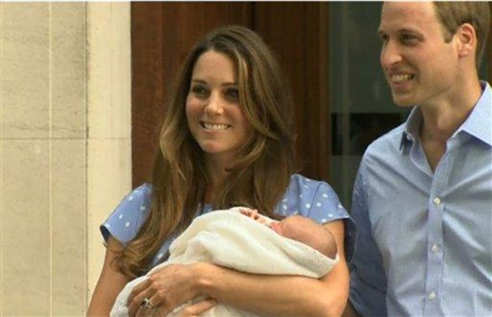 Photo - In this image from video, The Duke and Duchess of Cambridge leave the Lindo Wing of St Mary's Hospital in London Tuesday, carrying their newborn son, the Prince of Cambridge, who was born Monday, into public view for the first time. The boy will be third in line to the British throne. (AP Photo/APTN)
