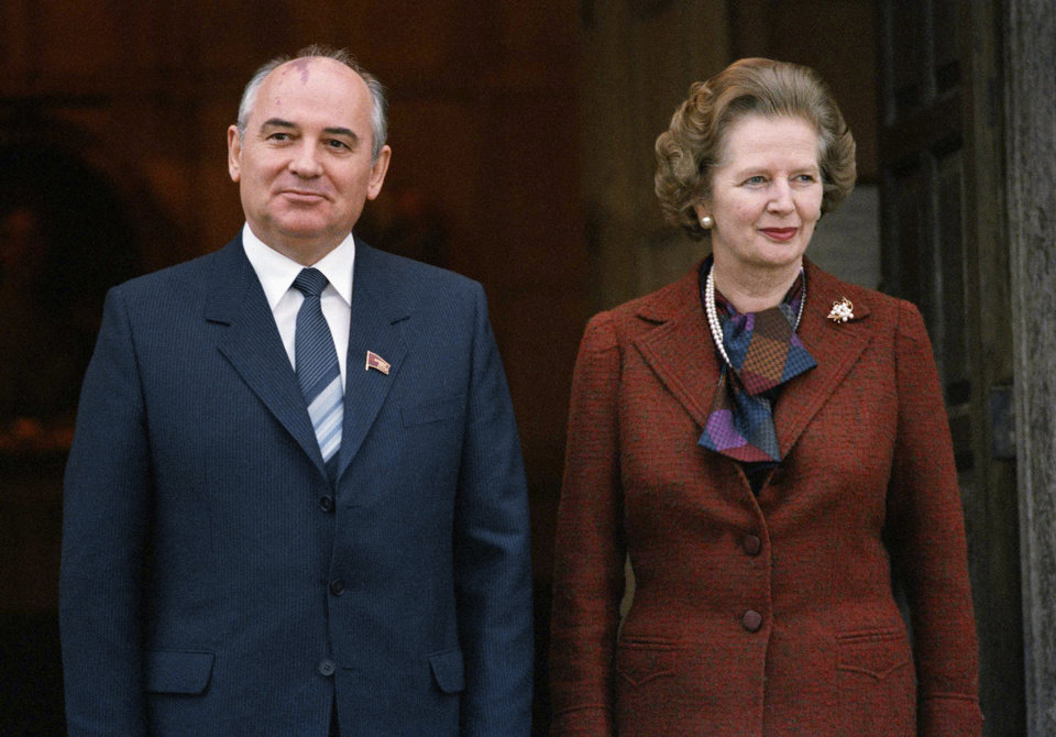 Photo - FILE - In this Dec. 15, 1984 file photo, Mikhail S. Gorbachev poses with Britain's Prime Minister Margaret Thatcher in London. Ex-spokesman Tim Bell says that Thatcher has died. She was 87. Bell said the woman known to friends and foes as