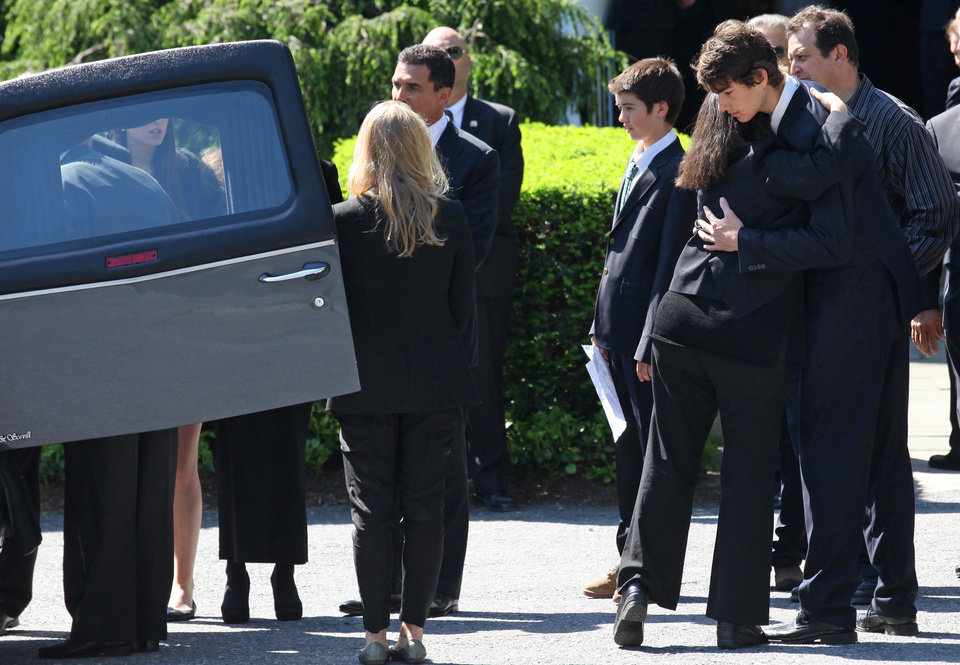 Photo -   Members of Mary Richardson Kennedy's family embrace as the casket holding Kennedy, the estranged wife of Robert F. Kennedy Jr., arrives at St. Patrick's Church in Bedford, N.Y. Saturday, May 19, 2012. Kennedy was found dead of an apparent suicide this week at her home in Bedford. (AP Photo/Craig Ruttle)