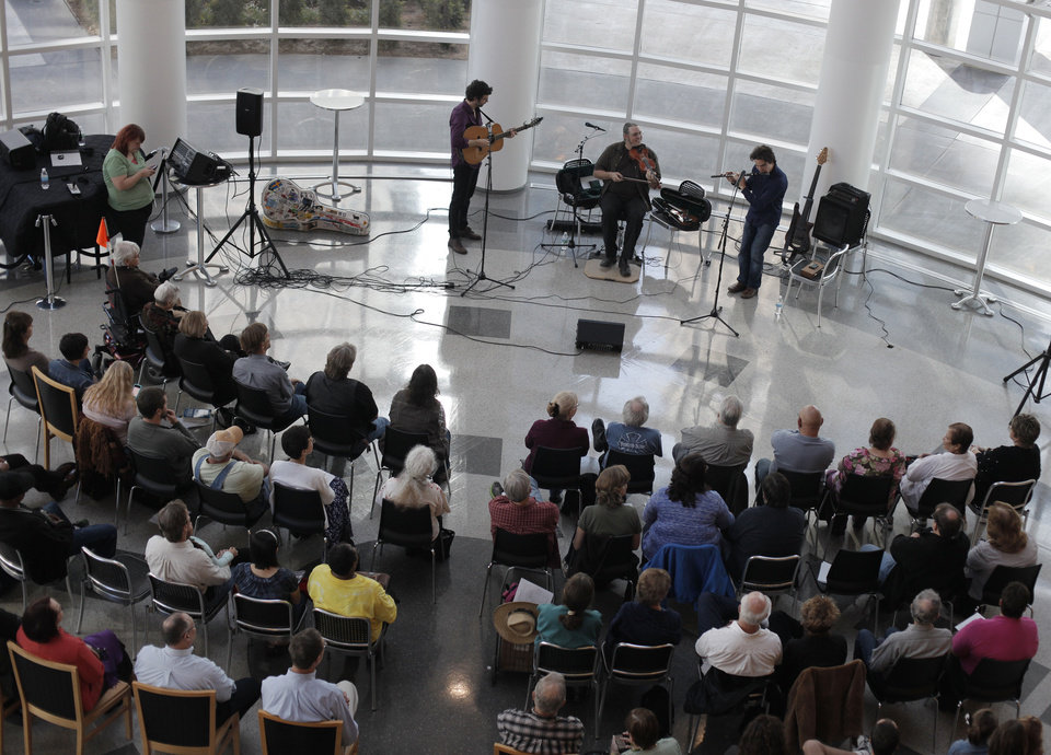 Photo - Canadian folk trio, Genticorum, performs at the Ronald J. Norick Downtown Library in Oklahoma City.  Photo by Garett Fisbeck, The Oklahoman  GARETT FISBECK - GARETT FISBECK