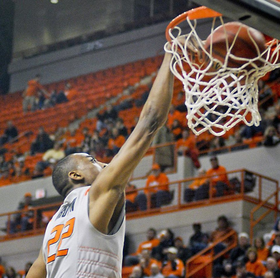 Photo - Oklahoma State's Markel Brown dunks against Iowa State during an NCAA college basketball game on Tuesday, Feb. 7, 2012, in Stillwater, Okla. (AP Photo/The Tulsa World, KT King)  ONLINE OUT; TV OUT; TULSA OUT ORG XMIT: OKTUL207