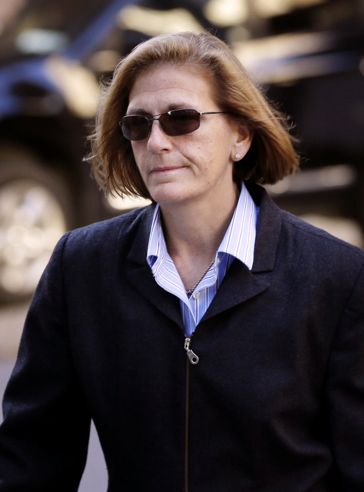 Photo - FILE - In this Oct. 8, 2013 file photo, JoAnn Crupi arrives to federal court in New York, Tuesday. The longtime secretary of imprisoned financier Bernard Madoff is one of five former employees of the imprisoned financier convicted Monday, March 24, 2014 in New York, at the end of a six-month trial that portrayed them as telling an elaborate web of lies to hide a fraud that enriched them and cheated investors out of billions of dollars. . (AP Photo/Seth Wenig, File)