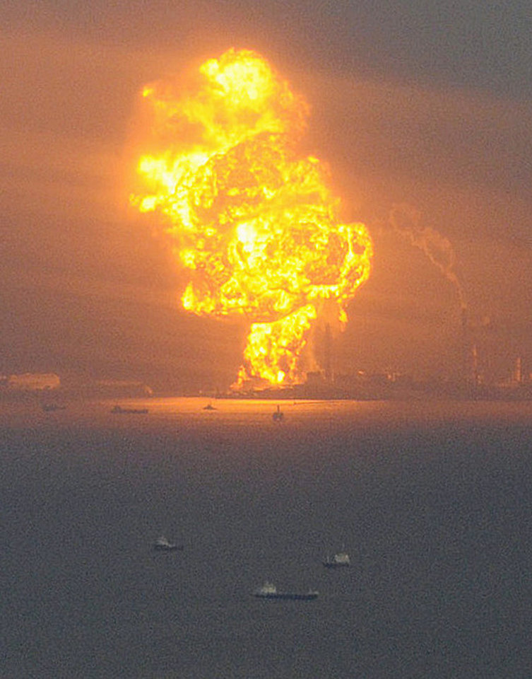 Photo - Flames rise from an oil refinery after a powerful earthquake in Ichihara, Chiba prefecture (state), Japan, Friday, March 11, 2011. The largest earthquake in Japan's recorded history slammed the eastern coast Friday. (AP Photo/Kyodo News) JAPAN OUT, MANDATORY CREDIT, FOR COMMERCIAL USE ONLY IN NORTH AMERICA ORG XMIT: TOK809