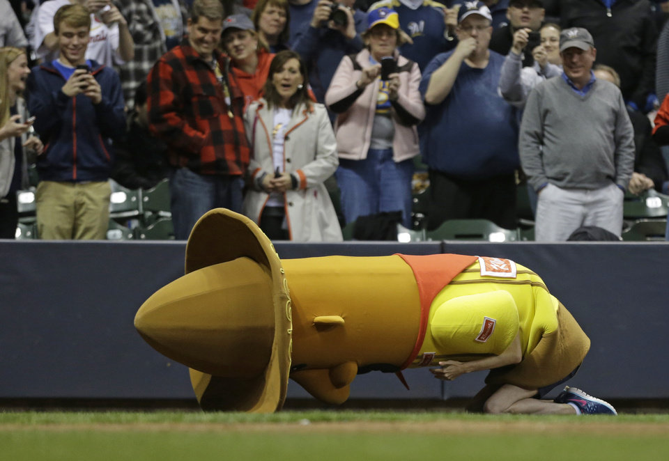 Photo - One of the racing sausages falls down during the sixth inning of MLB National League baseball game between the St. Louis Cardinals and Milwaukee Brewers Monday, April 14, 2014, in Milwaukee. (AP Photo/Jeffrey Phelps)