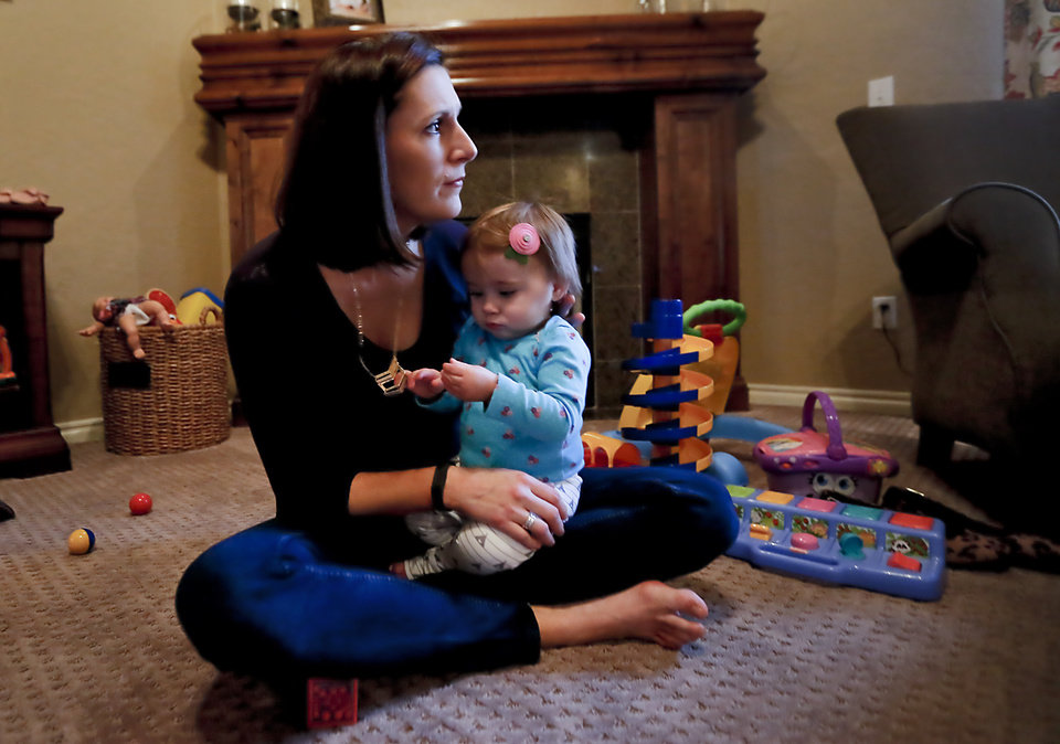 Photo -  Becky Endicott holds her daughter Julia, 10 months, at their home in Edmond. Photo by Chris Landsberger, The Oklahoman    CHRIS LANDSBERGER -  CHRIS LANDSBERGER
