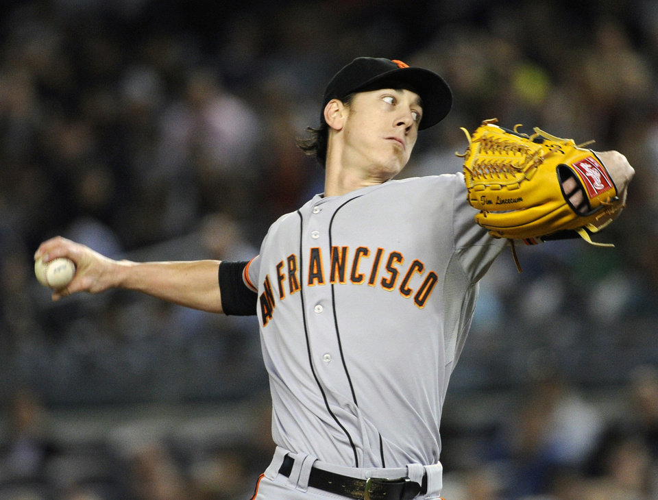 Photo - San Francisco Giants pitcher Tim Lincecum delivers the ball during the first inning of an interleague baseball game against the New York Yankees, Friday, Sept. 20, 2013, at Yankee Stadium in New York. (AP Photo/Bill Kostroun)