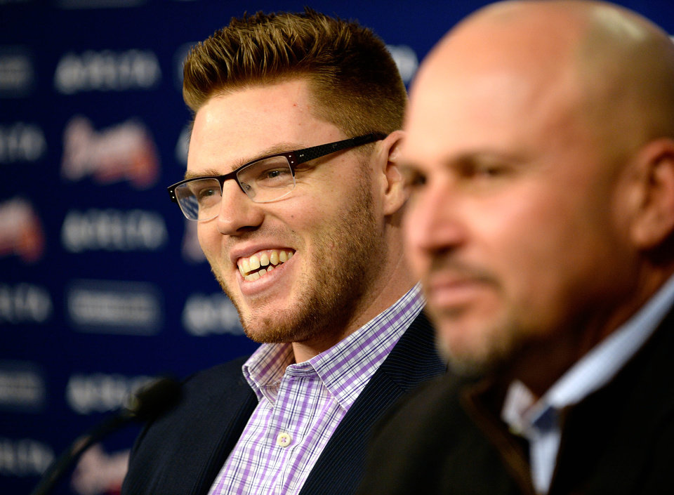 Photo - Atlanta Braves first baseman Freddie Freeman, left, sits next to manager Fredi Gonzalez on Wednesday, Feb. 5, 2014, in Atlanta. Freeman said Wednesday his $135 million, eight-year deal shows he should simply continue on his current path to becoming one of the best first basemen. (AP Photo/Atlanta Journal-Constitution, David Tulis) GWINNETT OUT  MARIETTA OUT  LOCAL TV OUT (WXIA, WGCL, FOX 5)