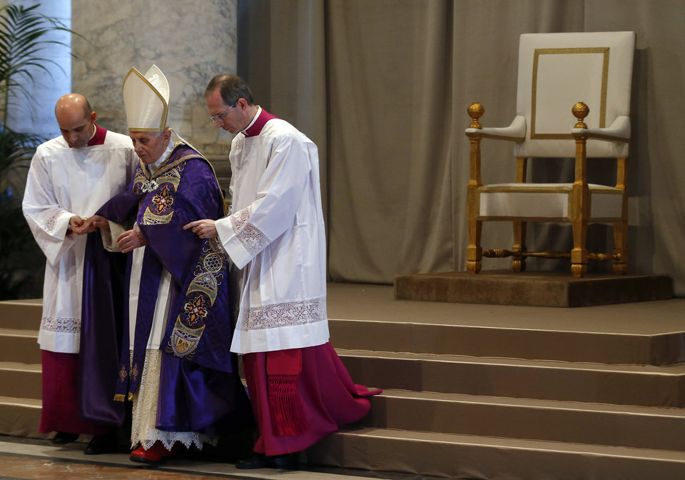 Photo - Pope Benedict XVI arrives in St. Peter's Basilica on the occasion of the celebration of Ash Wednesday mass at the Vatican, Wednesday, Feb. 13, 2013.  Ash Wednesday marks the beginning of Lent, a solemn period of 40 days of prayer and self-denial leading up to Easter. Pope Benedict XVI told thousands of faithful Wednesday that he was resigning for