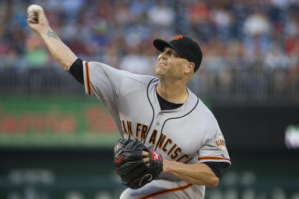 Photo - San Francisco Giants starting pitcher Tim Hudson delivers during the first inning of a baseball game against the Washington Nationals on Friday, Aug. 22, 2014, in Washington. (AP Photo/Evan Vucci)