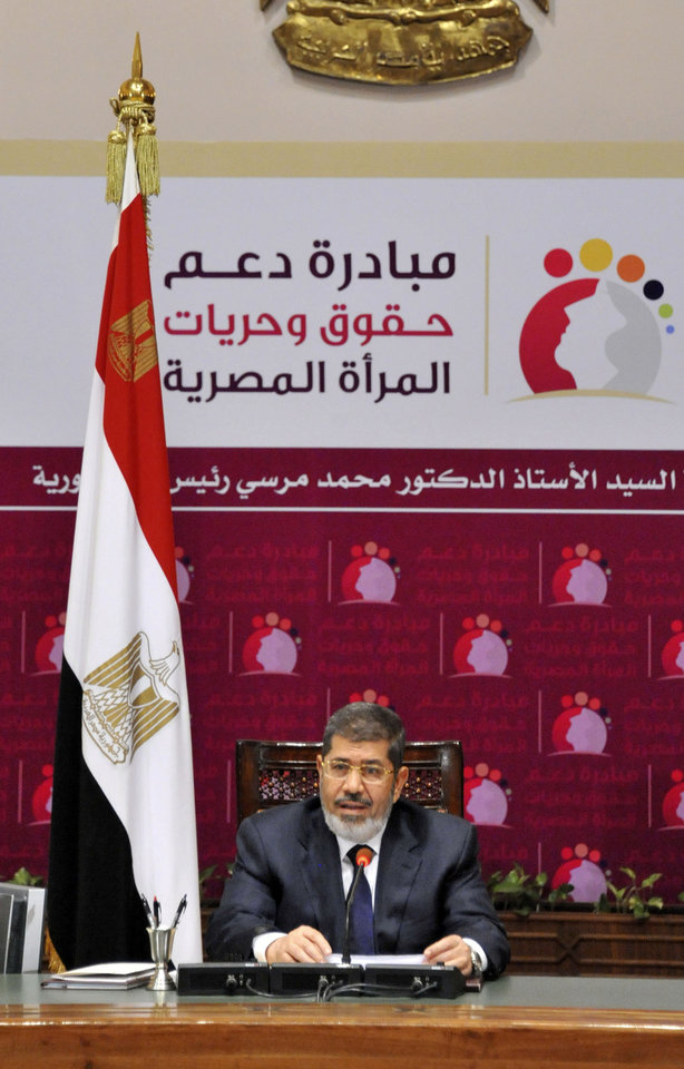 "Photo - In this image released by the Egyptian Presidency, Egyptian President Mohammed Morsi speaks at a conference on women's rights held at the Presidential palace in Cairo, Egypt, Sunday, March 24, 2013. Egypt's president delivered a stern warning to his opponents on Sunday, saying he may be close to taking unspecified measures to ""protect this nation"" two days after supporters of his Muslim Brotherhood and opposition protesters fought street battles in the worst bout of political violence in three months. (AP Photo/Egyptian Presidency)"