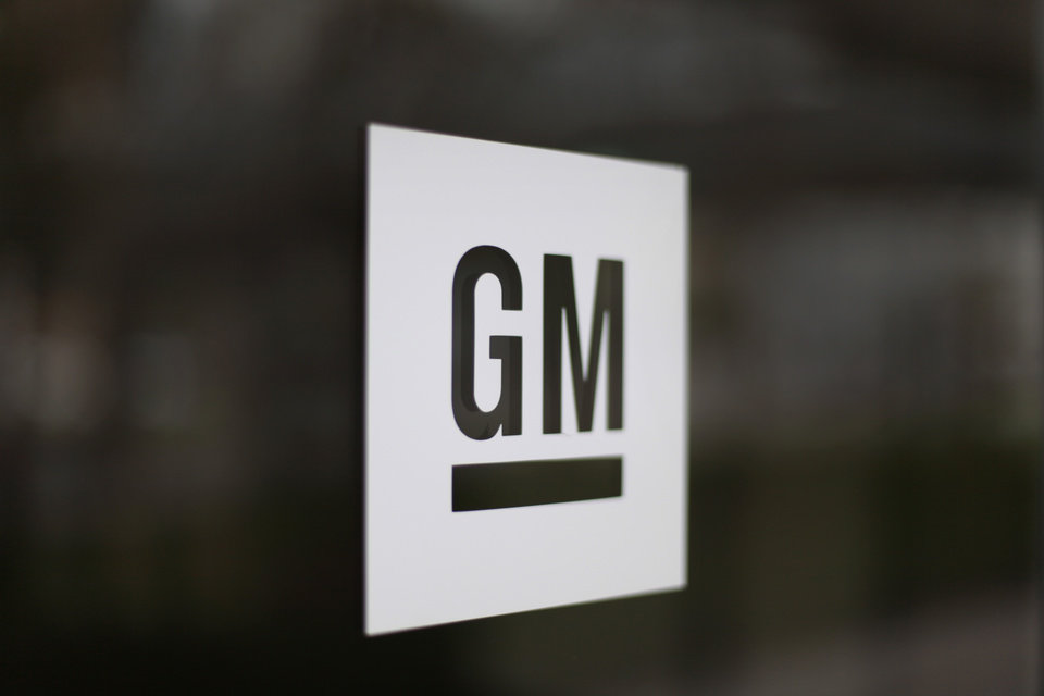 This Friday, May 16 2014 photo shows the General Motors logo at the company's world headquarters in Detroit. U.S. safety regulators fined General Motors a record $35 million Friday for taking at least a decade to disclose defects with ignition switches in small cars that are now linked to at least 13 deaths. (AP Photo/Paul Sancya)