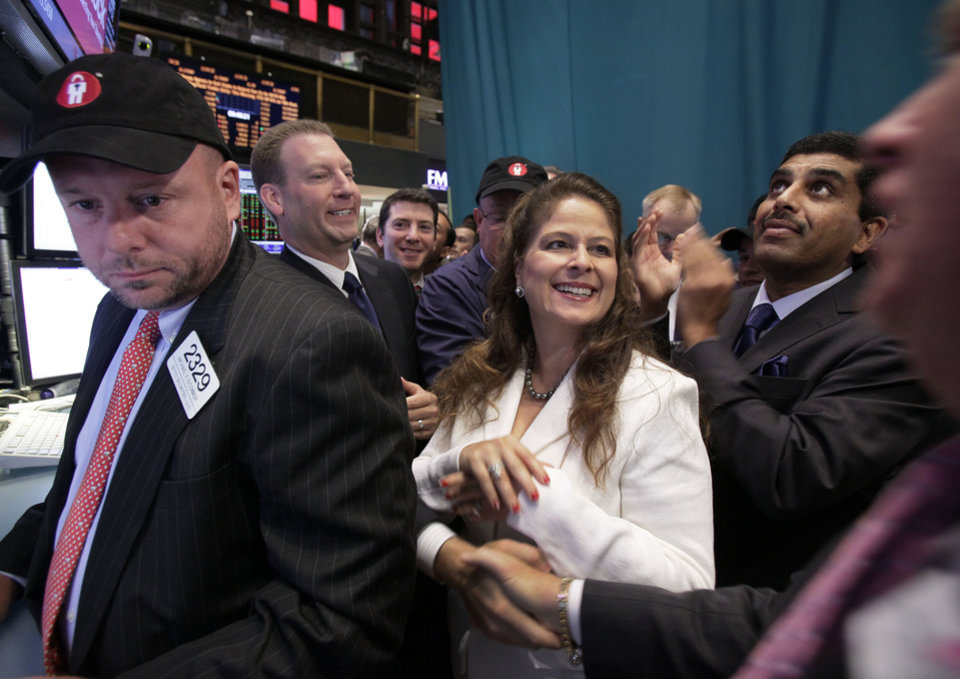 Photo -   LifeLock Chairman and CEO Todd Davis, second left, is congratulated as his company's stock begins trading on the floor of the New York Stock Exchange Wednesday, Oct. 3, 2012. Joining in the occasion are company General Counsel Clarissa Cerda, center, and Chief Product Officer Prakash Ramamurthy, second from right. (AP Photo/Richard Drew)