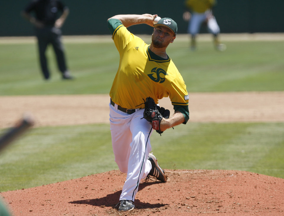 Photo - Sacramento State pitcher Justin Dillon delivers against Cal Poly during the second inning of an NCAA college baseball tournament regional game at Baggett Stadium at Cal Poly on Sunday, June 1, 2014, in San Luis Obispo, Calif. (AP Photo/Aaron Lambert)