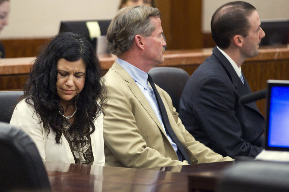 Photo - Ana Trujillo reacts after being found guilty of killing her boyfriend, after the jury deliberated less than two hours, on Tuesday, April 8, 2014, in Houston. Trujillo, 45, was found guilty of fatally stabbing her boyfriend with the stiletto heel of her shoe, hitting him at least 25 times in the face. (AP Photo/Houston Chronicle, Brett Coomer)