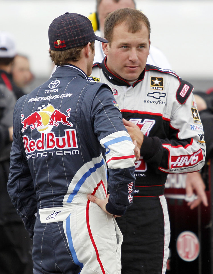 NASCAR drivers Ryan Newman, right, and Kasey Kahne talk on pit road as they wait out a rain delay during qualifying for Sunday's NASCAR Sylvania 300 auto race at New Hampshire Motor Speedway, Friday, Sept. 23, 2011, in Loudon, N.H. Newman won the pole and Kahne placed second. (AP Photo/Mary Schwalm)