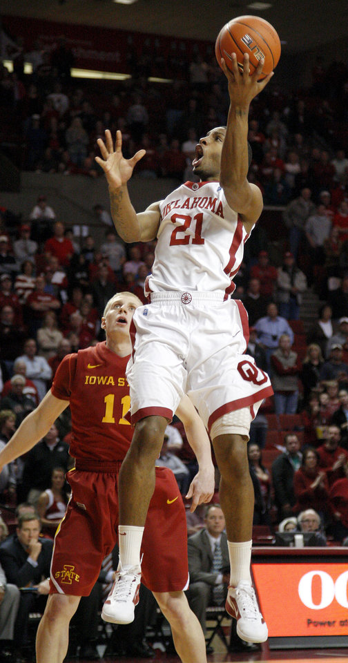 Oklahoma's Cameron Clark (21) goes past Iowa State's Scott Christopherson (11) during an NCAA basketball game between the University of Oklahoma Sooners (OU) and the Iowa State Cyclones (ISU) at the Lloyd Noble Center in Norman, Saturday, Feb. 4, 2012. Photo by Bryan Terry, The Oklahoman