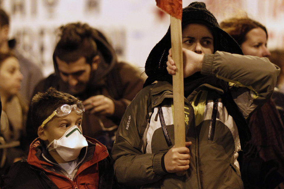 Photo -   A child marches along with protesters during a protest in Athens on Saturday, Nov. 17, 2012. Several thousand marchers are commemorating the 39th anniversary of a deadly student uprising against the then ruling dictatorship, with more than 6,000 police deployed in the center of the Greek capital. (AP Photo/Kostas Tsironis)