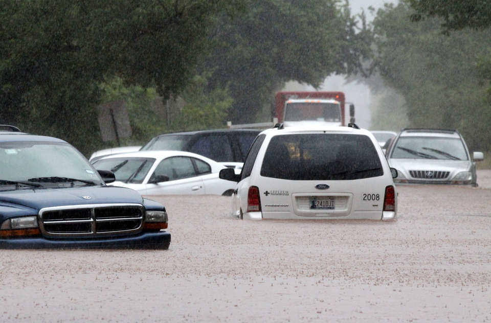 Photo - Cars are almost covered in water on Hefner Road just east of the Broadway Extension in Oklahoma City, OK, Monday, June 14, 2010. By Paul Hellstern, The Oklahoman
